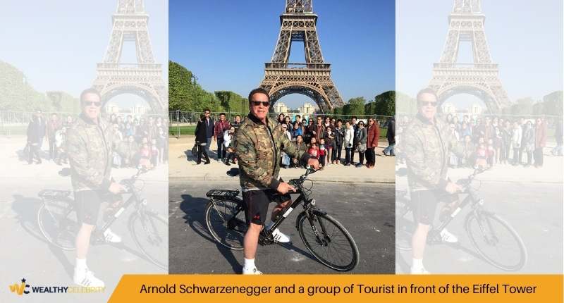 Arnold Schwarzenegger and a group of Tourist in front of the Eiffel Tower